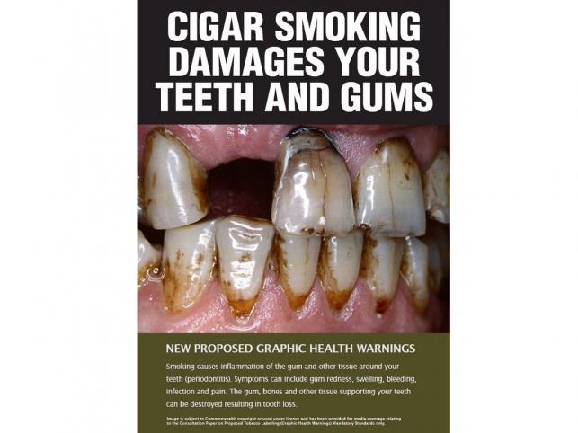 Plakietka ostrzegająca przed chorobami zębów i dziąseł
