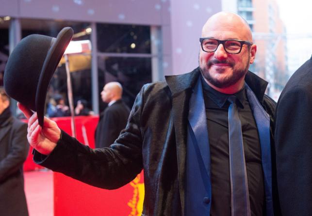 """Piotr Gąsowski na uroczystej premierze """"Pod elektrycznymi chmurami"""" w Berlinie"""